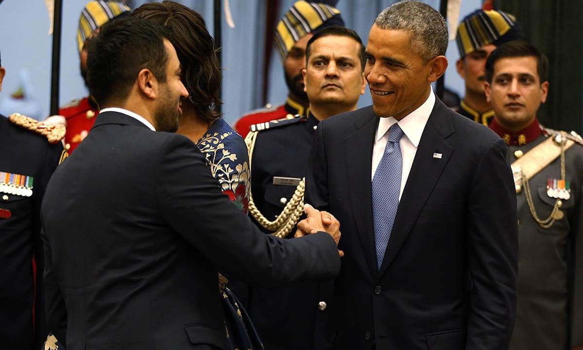US President Barack Obama talks with Indian American movie actor and former Obama administration official Kal Penn (originally named Kalpen Suresh Modi) as Obama participates in a receiving line before a State Dinner at the Rashtrapati Bhavan presidential palace in New Delhi January 25, 2015.— Reuters