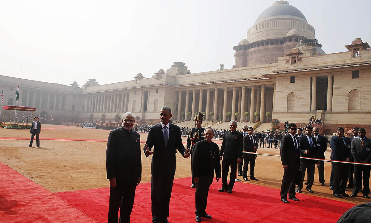 US President Barack Obama (C) talks to the media next to Indian Prime Minister Narendra Modi (L) and President Pranab Mukherjee in front of the Rashtrapati Bhavan presidential palace in New Delhi January 25, 2015.   — Reuters