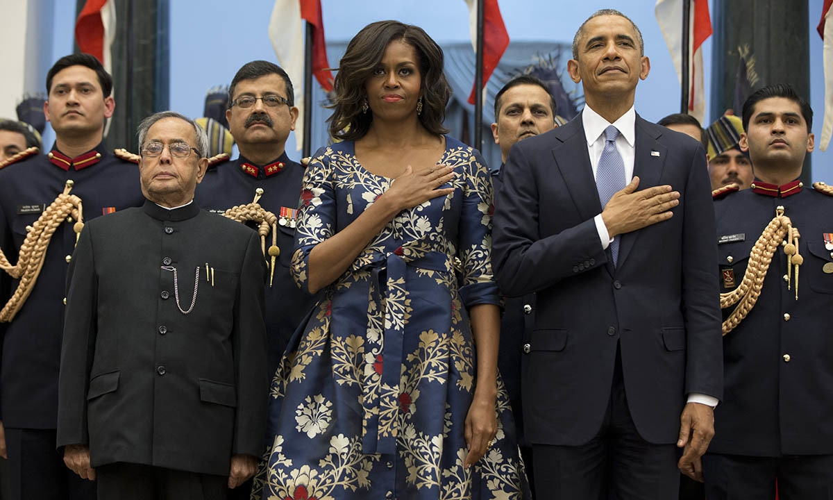 President Barack Obama, right, first lady Michelle Obama and Indian President Pranab Mukherjee, left, stand during the US National Anthem before a receiving line at the State Dinner at the Rashtrapati Bhavan, the presidential palace, in New Delhi, India, Sunday, Jan. 25, 2015. — AP