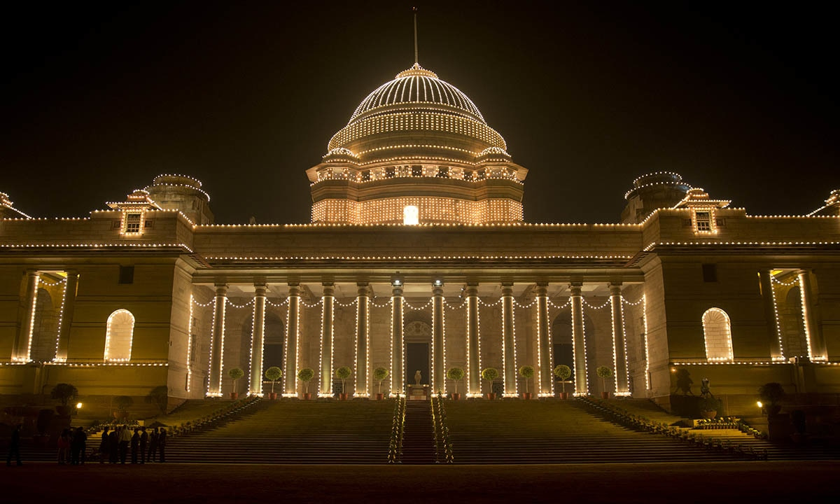 The illuminated Rashtrapati Bhavan, the presidential palace, is seen before President Barack Obama and first lady Michelle Obama and Indian President Pranab Mukherjee participate in a State Dinner, in New Delhi, India, Sunday, Jan. 25, 2015. — AP