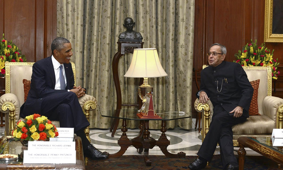 US President Barack Obama (L) smiles during a meeting with his Indian counterpart Pranab Mukherjee at India's presidential palace Rashtrapati Bhavan in New Delhi in this January 25, 2015 picture provided by India's Presidential Palace. — Reuters