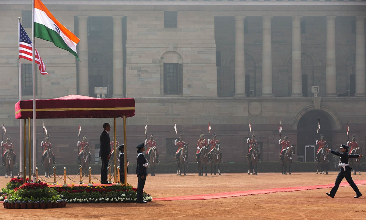 US President Barack Obama looks out from a viewing stand during an arrival ceremony at Rashtrapati Bhavan, the presidential palace, in New Delhi, India, Sunday, Jan. 25, 2015. — AP