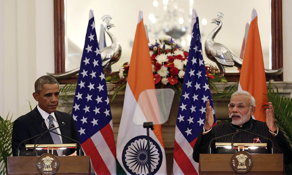 India's Prime Minister Narendra Modi reads a joint statement next to US President Barack Obama (L) at Hyderabad House in New Delhi January 25, 2015. — Reuters