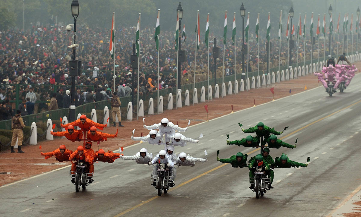 Indian Border Security Force (BSF) motorcycle specialists perform during the Indian Republic Day parade in New Delhi on January 26, 2015. — AFP