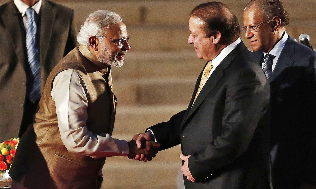 Prime Minister Narendra Modi in a handshake with his Pakistani counterpart Nawaz Sharif.  — Reuters