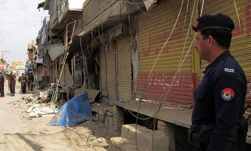 In this photo, police officials inspect a site in Dera Ismail Khan of Khyber Pakhtunkhwa province. — AFP/File