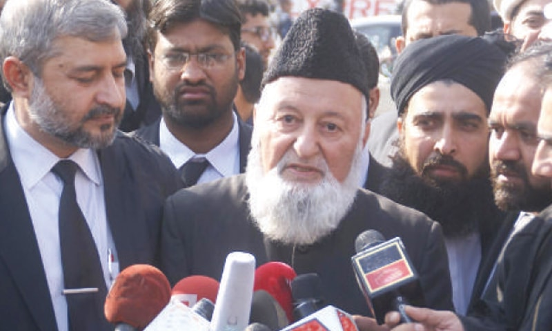 Mumtaz Qadri's defence lawyer retired Justice Mian Nazir Akhtar talks to the media on Tuesday.— INP