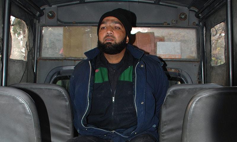 سابق گورنر پنجاب سلمان تاثیر کے قتل میں سزایافتہ مجرم ممتاز قادری—۔فائل فوٹو/ رائٹرز