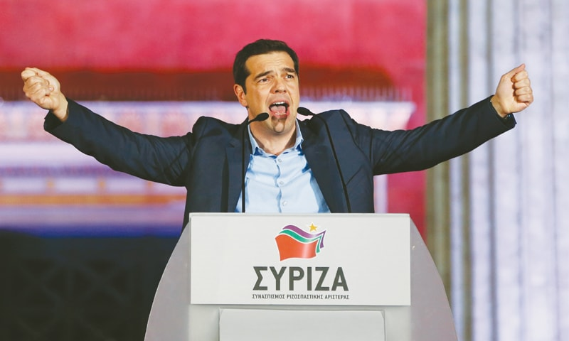 The head of leftist Syriza party Alexis Tsipras speaks to his supporters after winning the elections in Athens on Jan 25. — Reuters