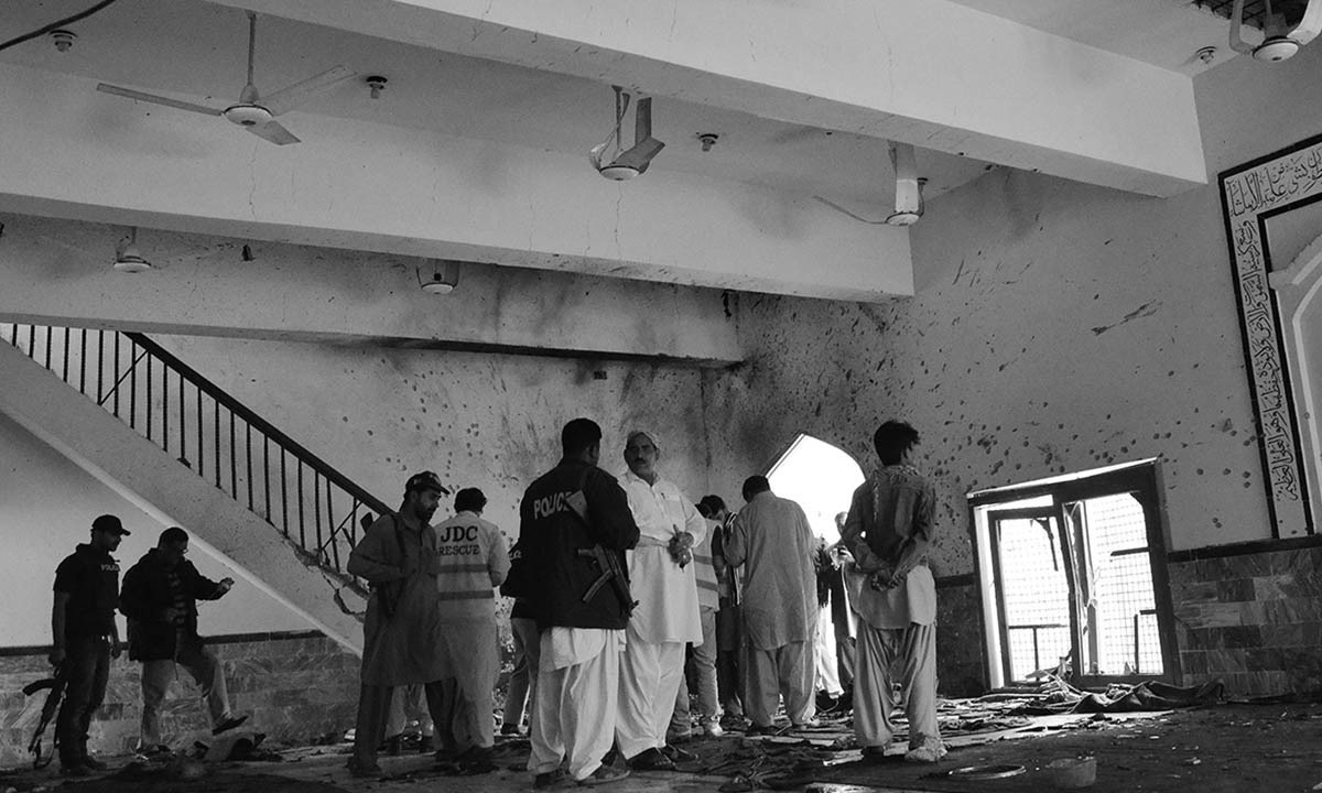 Pakistani security officials and police examine the scene following a bomb attack at a Shiite Muslim mosque in Shikarpur in Sindh province.—AFP/File