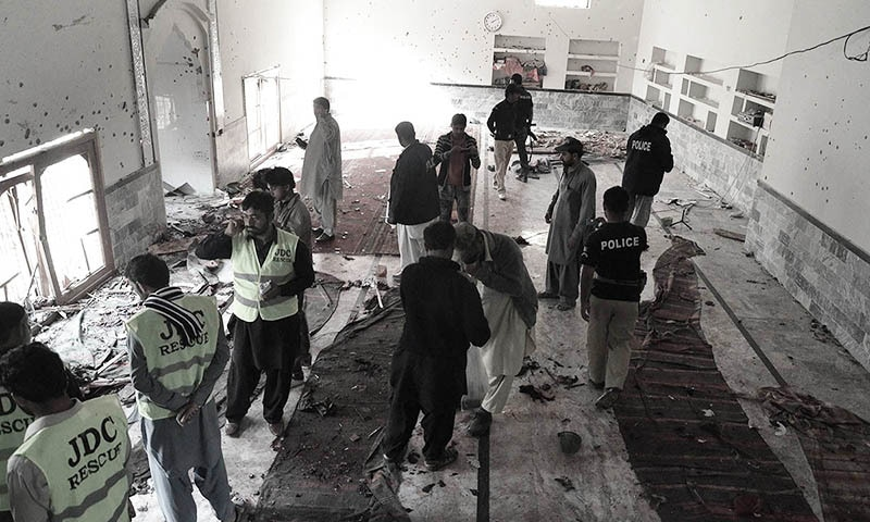 Pakistani security officials gather at the Shikarpur Imambargah after the blast on January 30. —AFP