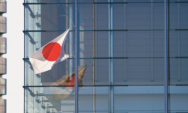 THE Japanese national flag flies at half mast to mourn the beheading of two Japanese hostages captured by the IS at Prime Minister Shinzo Abe's official residence in Tokyo on Monday.—Reuters