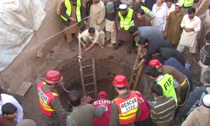 DawnNews screengrab showing rescue operations underway after a well collapsed in a Peshawar madrassa.