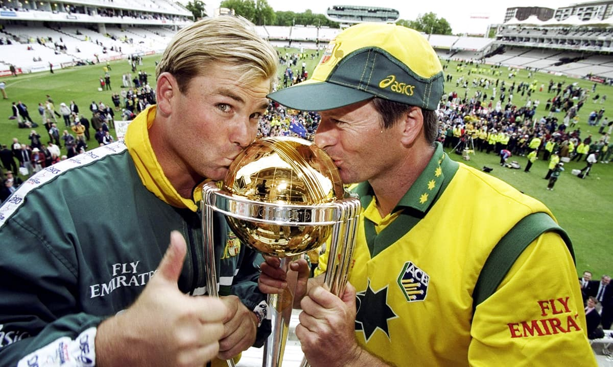 Shane Warne and Steve Waugh kisses the 1999 World Cup trophy. — Courtesy photo