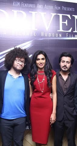 Michael Hudson, Amna Illyas and Kamran Faiq at the event.— Publicity photo