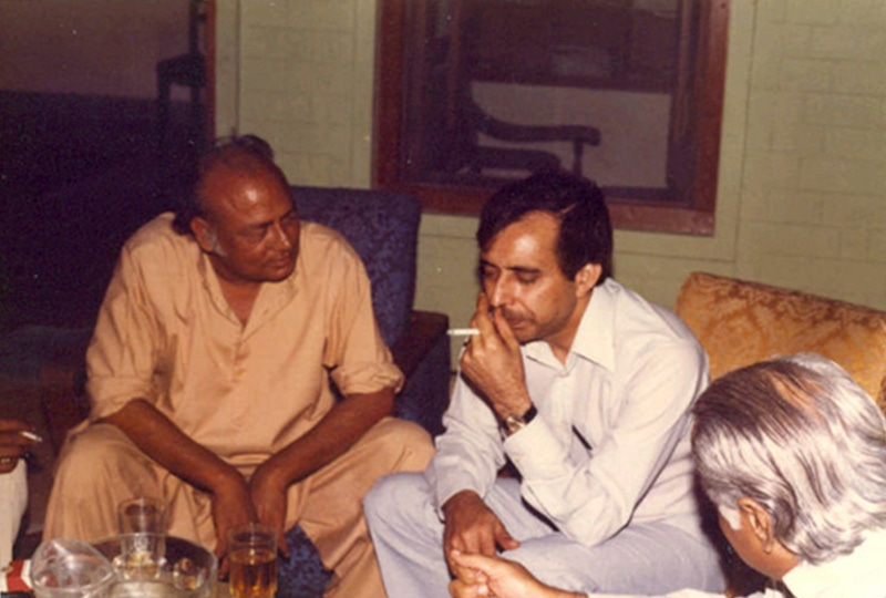 Famous revolutionary poet, late Habib Jalib, enjoys a drink with friends at a restaurant in Karachi in 1975.