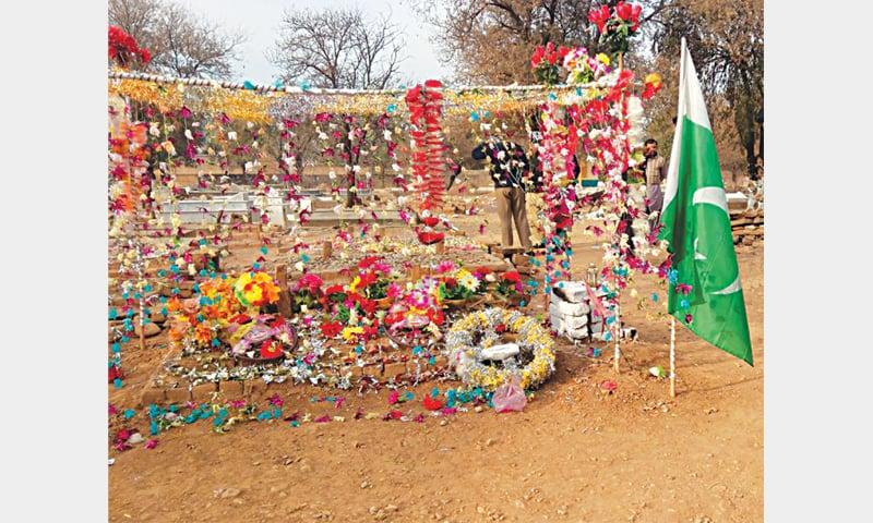 The sense of devotion is all too obvious at Aitzaz's last resting place in Ibrahim Zai village graveyard
