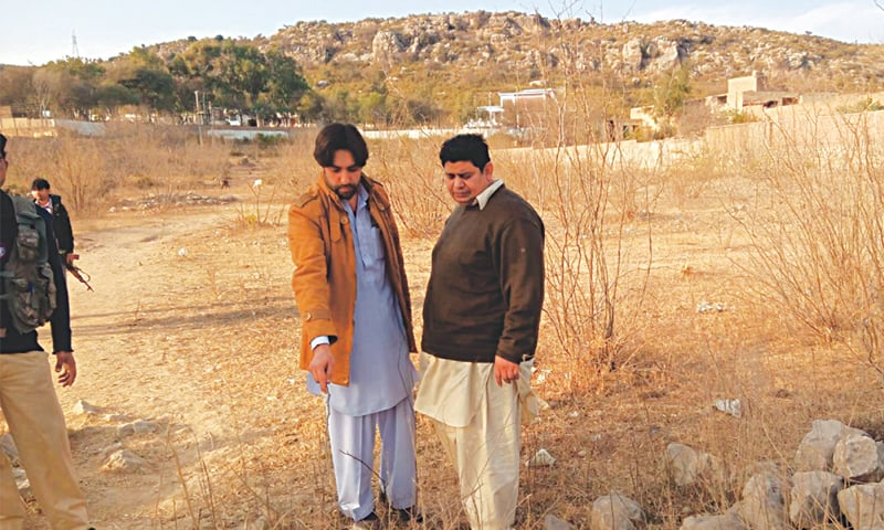 Mujtaba points to the spot where the suicide bomber blew himself up