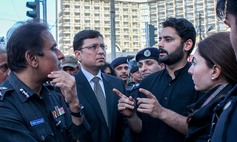 Jibran Nasir, Sharmila Farooqui and representatives from the police and the government at the sit-in on Tuesday. — Photo by Mohammad Umar