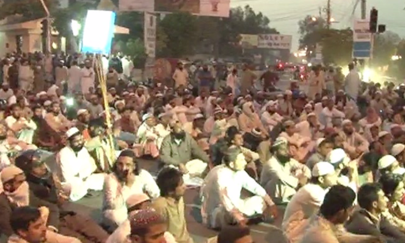 ASWJ activists during a rally near CM House. -DawnNews screengrab