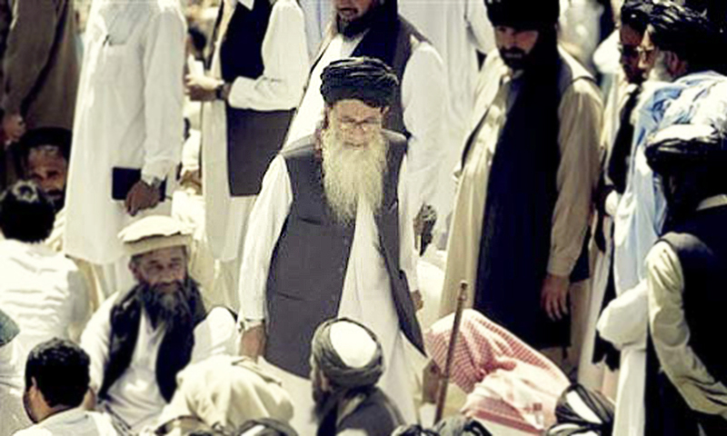 Pakistan's hardline cleric Sufi Muhammad, in center, arrives to address his supporters in Mingora, Swat on Sunday, April 19, 2009. — AP/File
