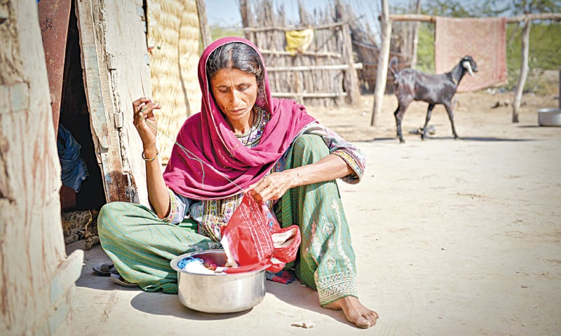 SHAH Bano, the mother of eight-year-old Ghulam Mohammad, quietly goes about her  daily chores. Her son is one of the 238 Pakistani fishermen languishing in Indian jails. —Fahim Siddiqi / White Star