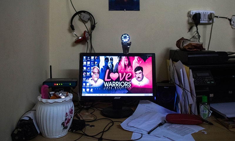 A screensaver depicting members of the Indian NGO the Love Commandos is seen on a computer at one of seven shelters for couples who have left home to have 'love marriages' run by the Love Commandos in New Delhi on September 21, 2014. — AFP
