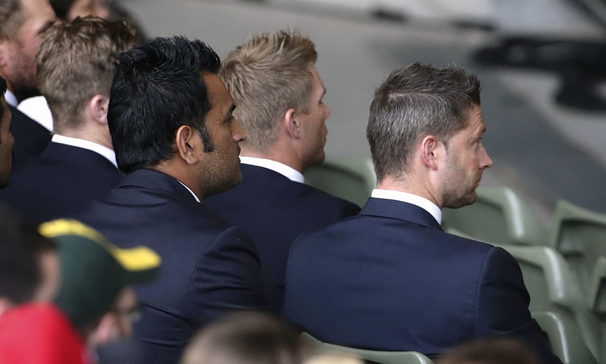 India's captain Mahendra Singh Dhoni (L) and Australia's captain Michael Clarke (R) watch the ICC World Cup 2015 opening event at the Sidney Myer Music Bowl in Melbourne on February 12, 2015. — Reuters