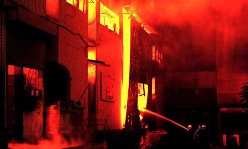 This file photo shows fire-fighters trying to control the blaze at the garment factory in Karachi. —Photo by AFP