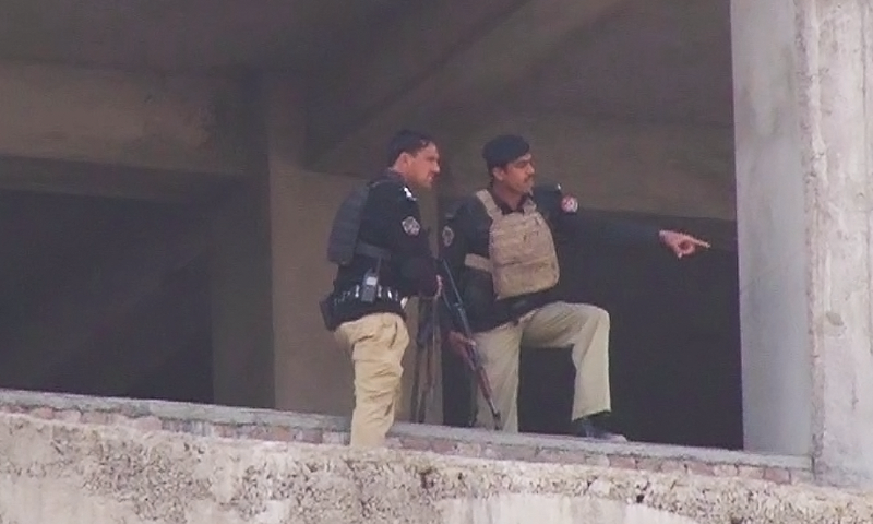 DawnNews screenshot shows security officials gesturing towards imambargah