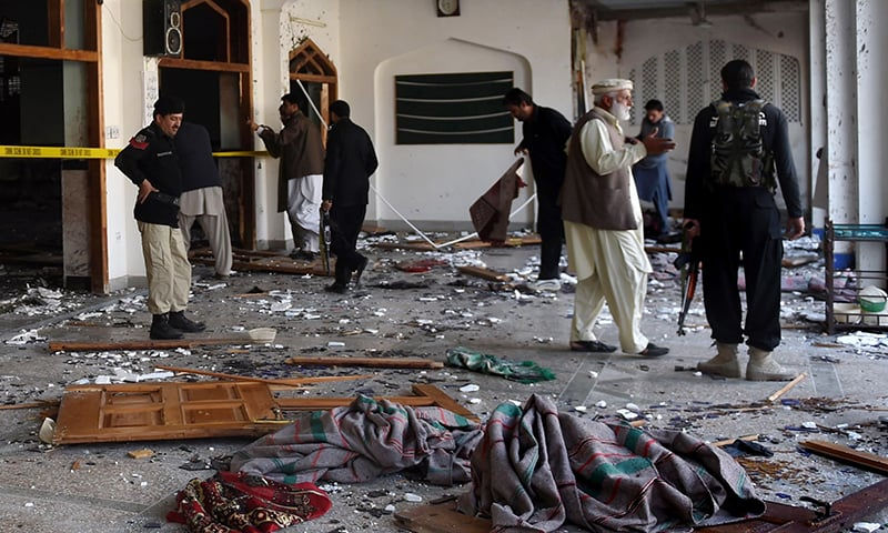 Security personnel inspect  a mosque inside Imamia Imambargah after an attack by Taliban militants in Peshawar on February 13, 2015. - AFP Photo