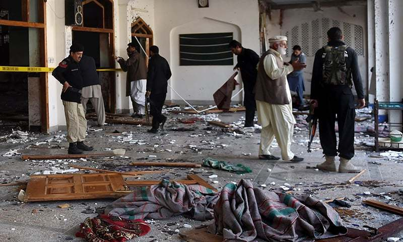 Security personnel inspect a mosque inside Imamia Imambargah after an attack by Taliban militants in Peshawar on February 13, 2015. - AFP/File