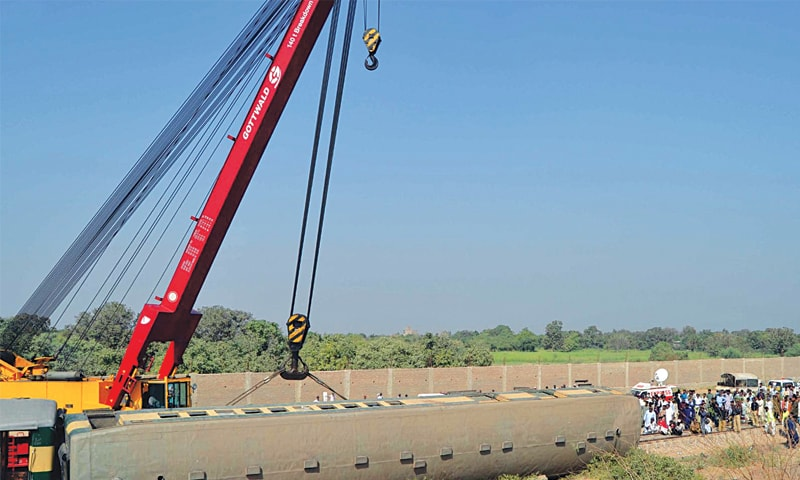 A CRANE is being used to put one of the derailed bogies back on track near the Detha railway station on Saturday.—INP