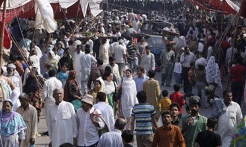 People visit a crowded weekly bazaar in Lahore.—AP/File
