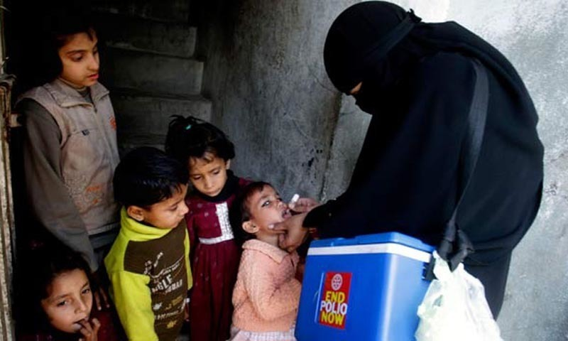 A health worker administers polio vaccination to children. — AFP/File