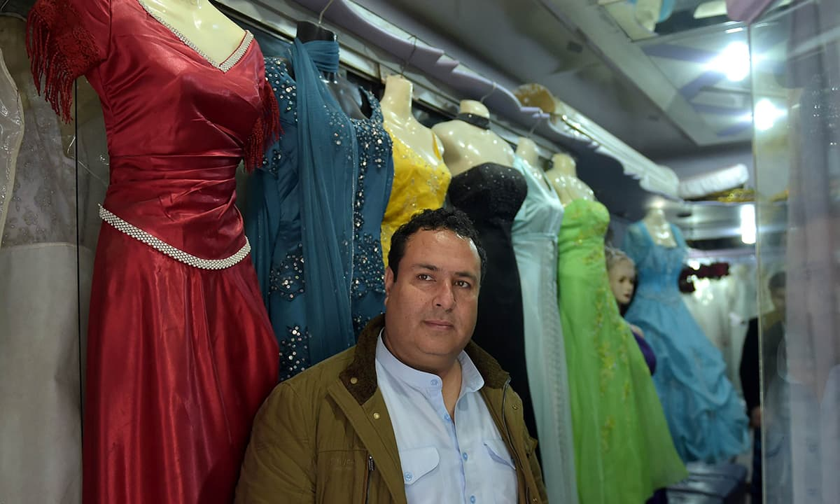 35319c92dd Afghan national of Tajik origin, Raza Sakhi poses in his bridal dress shop  in Islamabad