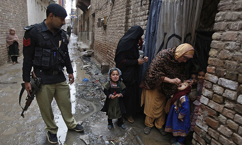 In this Monday, Feb. 16, 2015 photo, a Pakistani health worker gives a polio vaccine to a child in Peshawar, Pakistan.  — AP