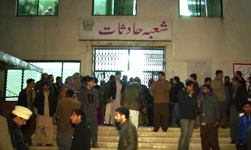 A crowd gathers outside the hospital emergency ward as news about the attack spreads