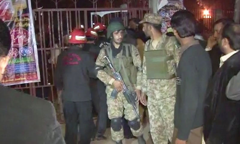 Security personnel gather outside the Rawalpindi imambargah. - DawnNews screengrab