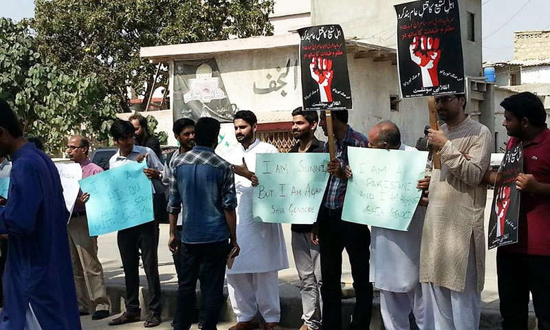 Human shield formed outside Karachi imambargah to send 'message of unity'