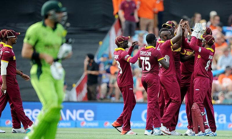 West Indies player's celebrate after dismissing Pakistan's captain Misbah-ul-Haq, left. — AP