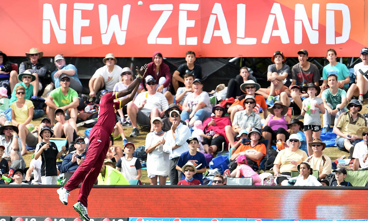 West Indies fieldsman Sulieman Benn attempts to take a catch on the boundary from a Pakistan batsman.  -AFP
