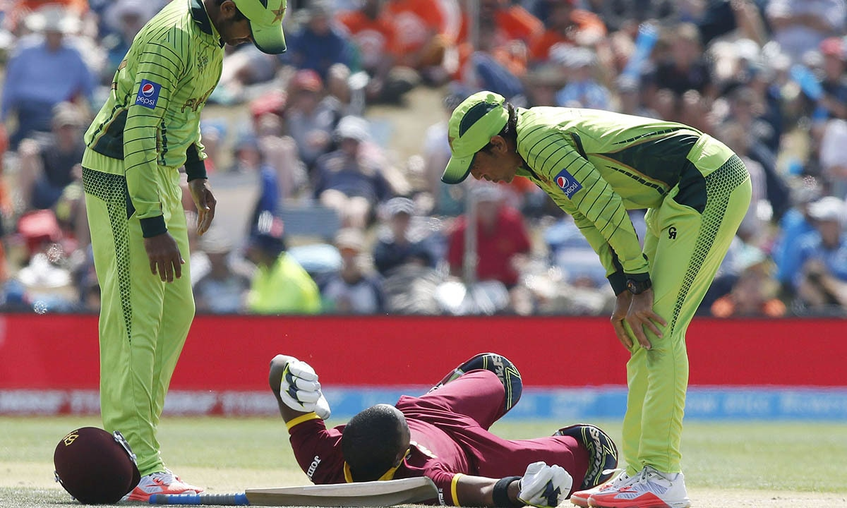 West Indies batsman Darren Bravo lies hurt, after diving to make the crease. -REUTERS