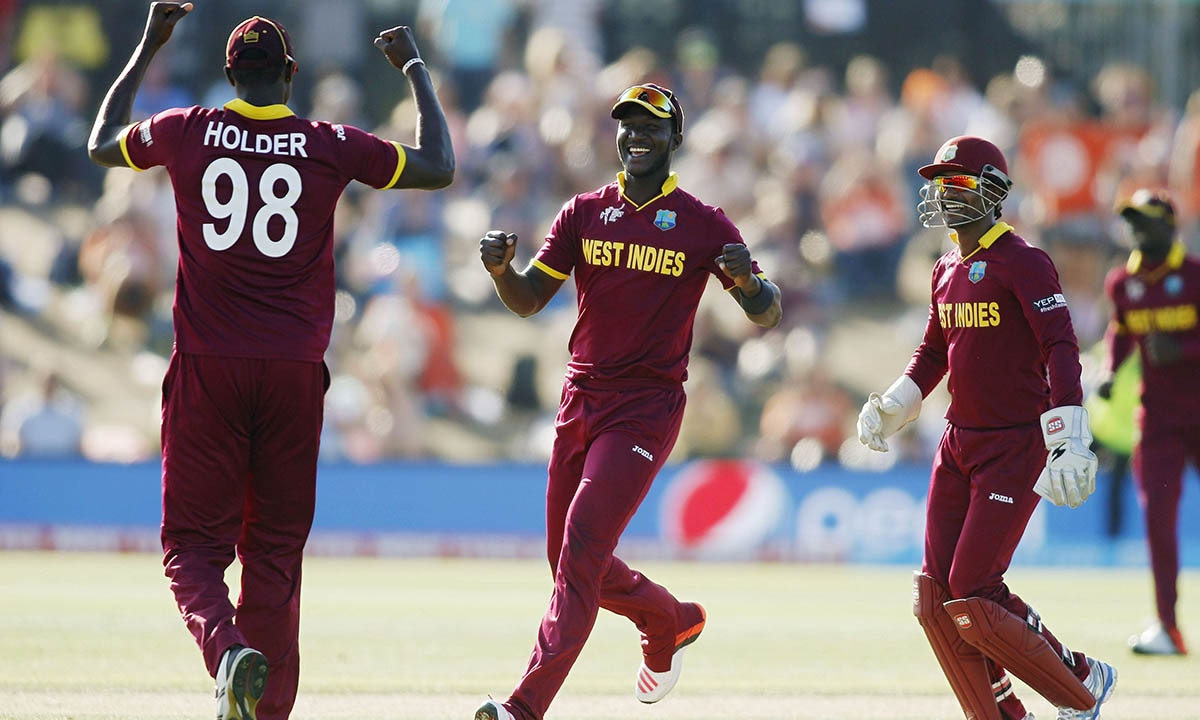 West Indies players Jason Holder, Darren Sammy and Denesh Ramdin (L - R) celebrate winning during their Cricket World Cup match against Pakistan. -REUTERS