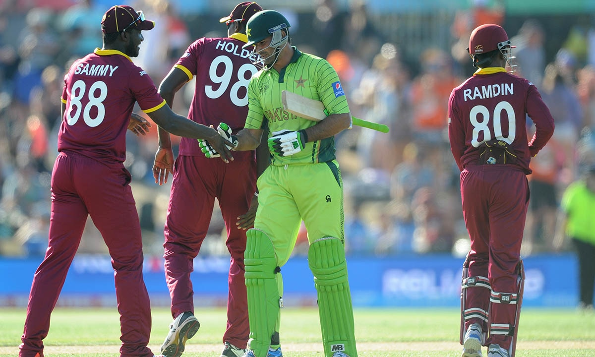 Pakistan's Sohail Khan congratulates West Indies Darren Sammy, left, after they lost their Cricket World Cup match by 150 runs. -AP