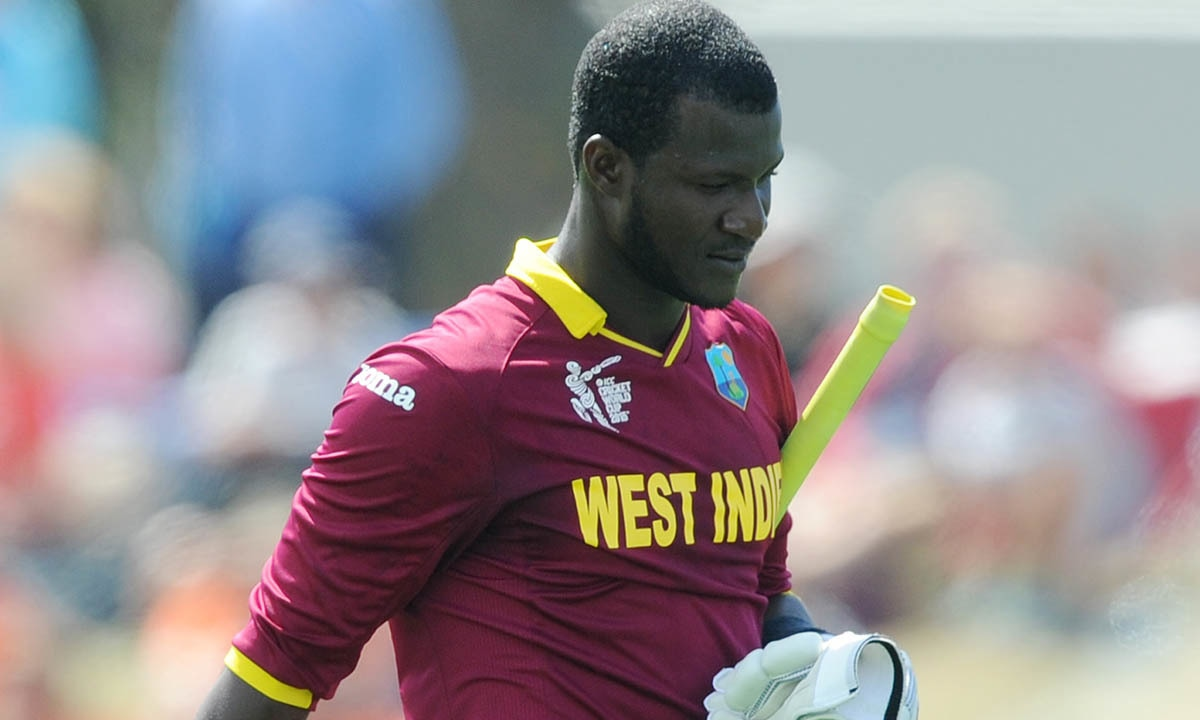 West Indies batsman Darren Sammy walks from the field after he was dismissed for 30 runs. -AP