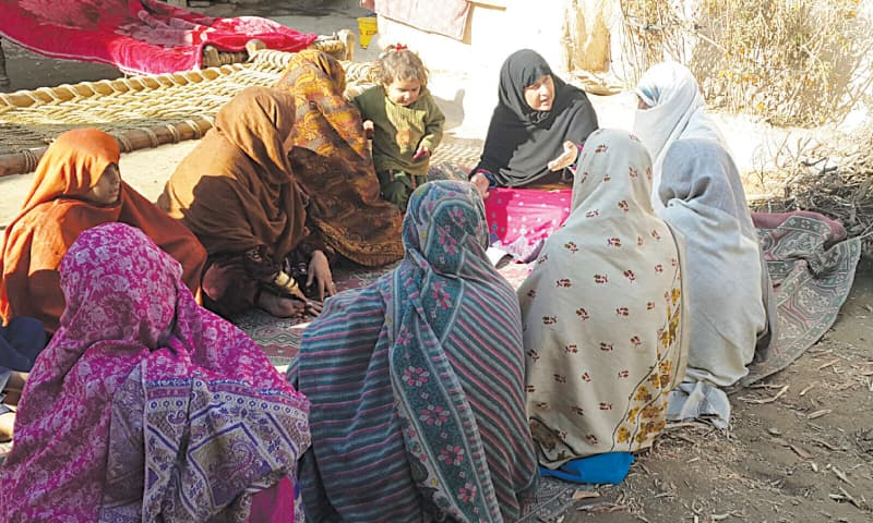 WOMEN assemble at a gathering for the Da Khwendo Jirga, a council of sisters, in the Aghwara Kela area of Swat. —Photo by writer