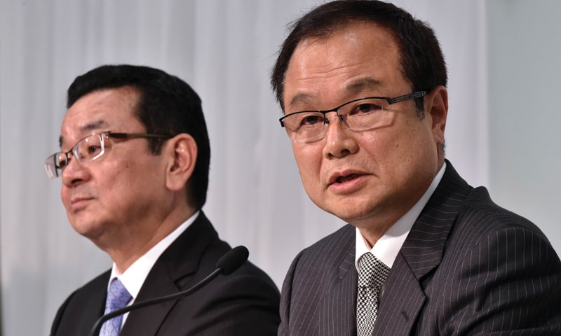 TOKYO: Newly appointed president of Japanese carmaker Honda Takahiro Hachigo (L) listens as current president Takanobu Ito (R) speaks during a press conference at the company's headquarters on Monday.—AFP