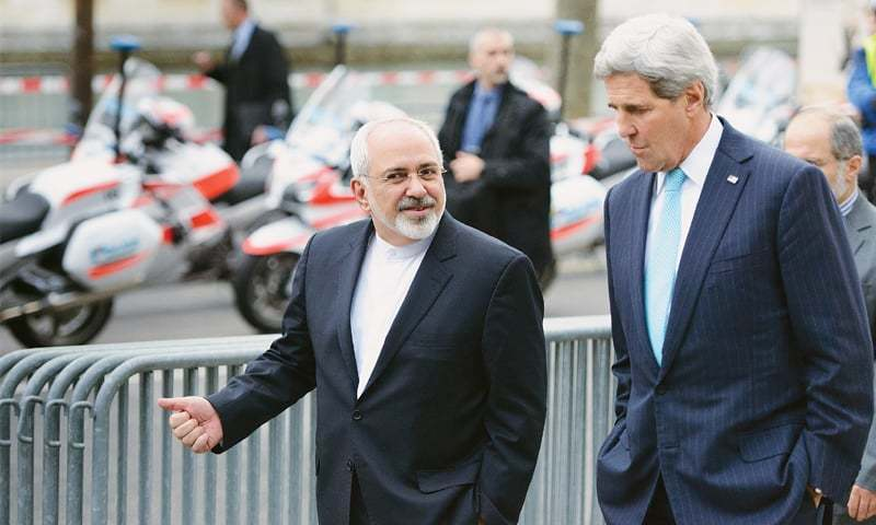 Iran Foreign Minister Javad Zarif pictured with United States Secretary of State John Kerry in a photo taken whilst Iran nuclear negotiations were ongoing. ─ AP/File
