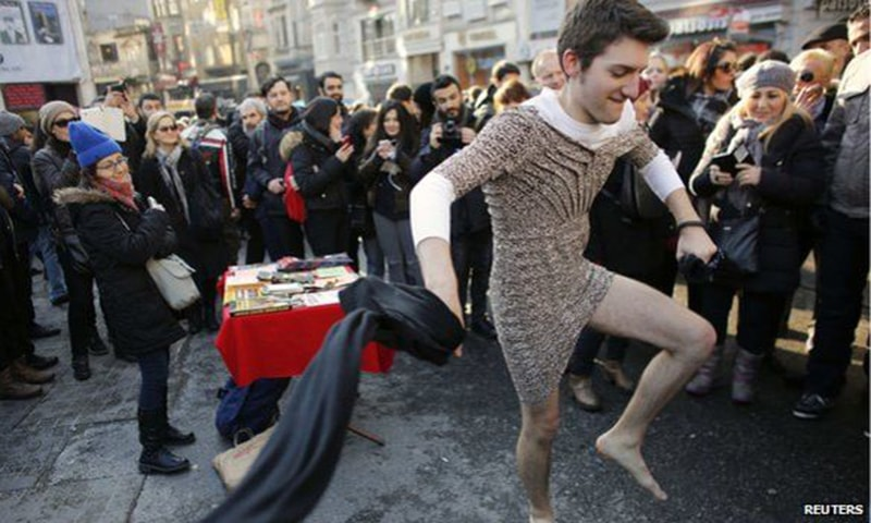 A man wearing a dress is seen during a march in Istanbul to support women's rights. -Reuters